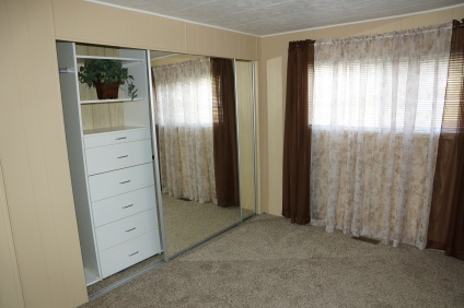 Bedroom with built in closet organizers
